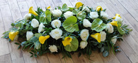 Yellow and White Casket Top